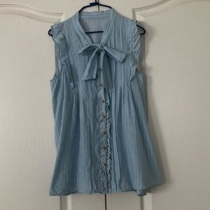 Blue sleeveless cotton blouse in small/onesize